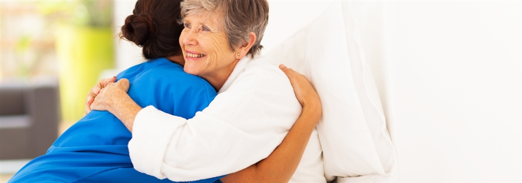 woman hugging health care professional